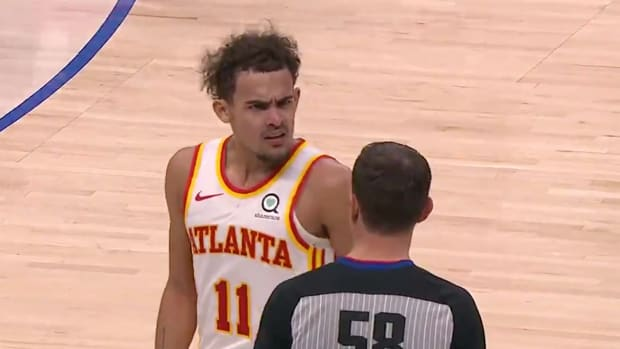 Trae Young argues with an official after not getting a foul call at the end of the game against the Mavericks on Feb. 10, 2021.