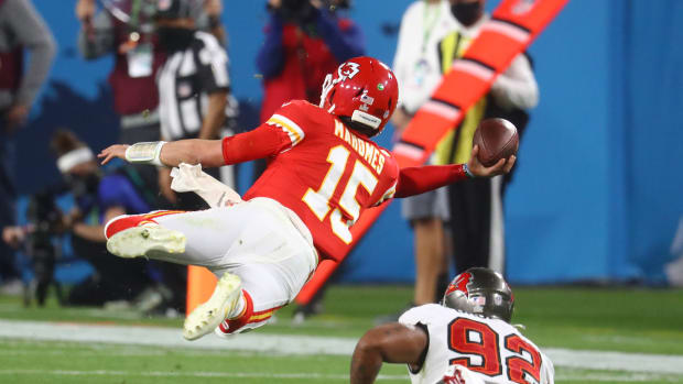 Feb 7, 2021; Tampa, FL, USA; Kansas City Chiefs quarterback Patrick Mahomes (15) throws a sidearm pass in the air against Tampa Bay Buccaneers defensive end William Gholston (92) during the fourth quarter in Super Bowl LV at Raymond James Stadium. Mandatory Credit: Mark J. Rebilas-USA TODAY Sports