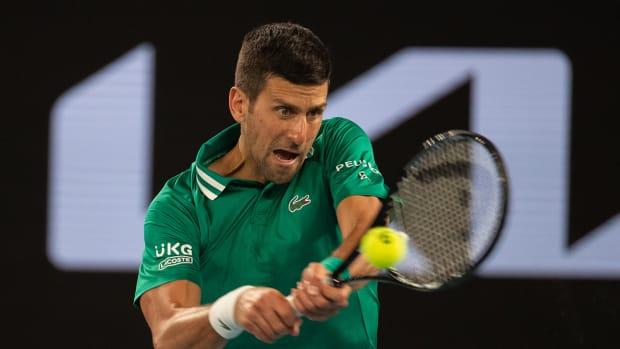 Novak Djokovic hits a return during a third-round match at the Australian Open