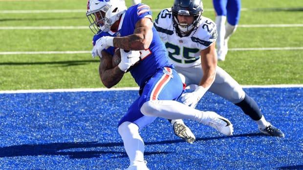 Bills safety Jordan Poyer (21) intercepts a pass as Seattle Seahawks running back Travis Homer (25) defends during the first quarter at Bills Stadium.