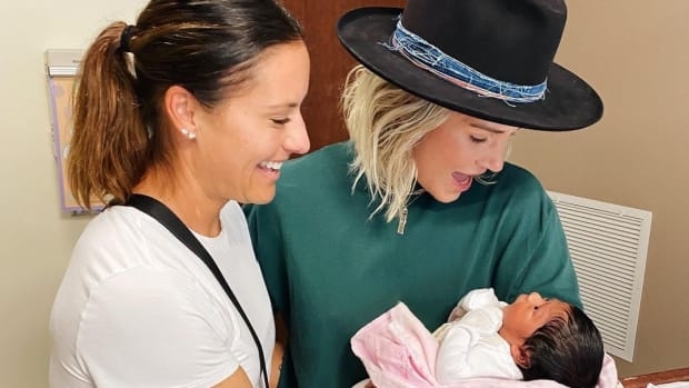 Ashlyn Harris and Ali Krieger of the U.S. women's national team welcome their adopted daughter Sloane.