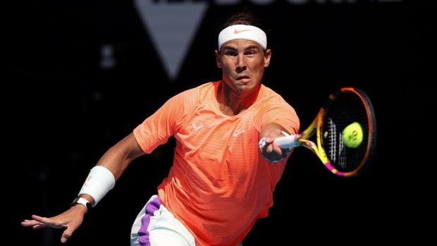 Rafael Nadal hits a return during the Australian Open