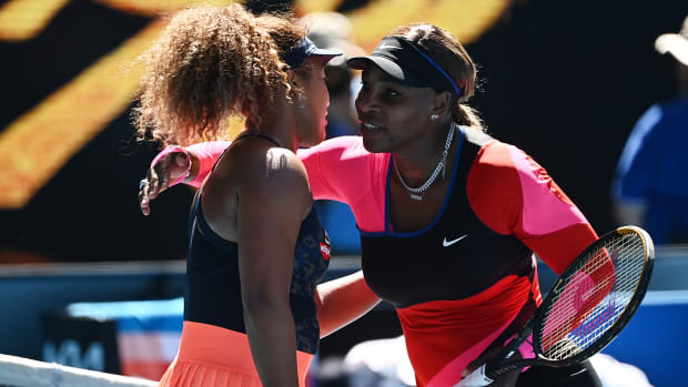 Naomi Osaka and Serena Williams embrace after their 2021 Australian Open match.