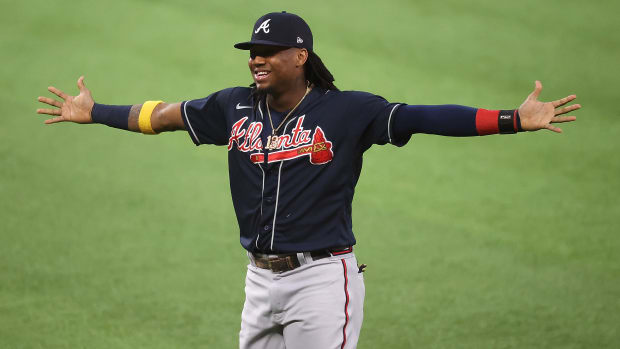 Braves outfielder Ronald Acuña Jr. with his arms outstretched