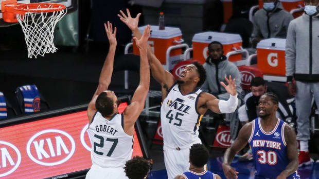 Jan 6, 2021; New York, New York, USA; Utah Jazz guard Donovan Mitchell (45) and center Rudy Gobert (27) go for a rebound against New York Knicks guard Elfrid Payton (6) and center Mitchell Robinson (23) during the first half at Madison Square Garden. Mandatory Credit: Wendell Cruz-USA TODAY Sports