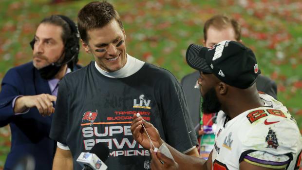 Tom Brady and Leonard Fournette celebrate following the Buccaneers' Super Bowl LV win