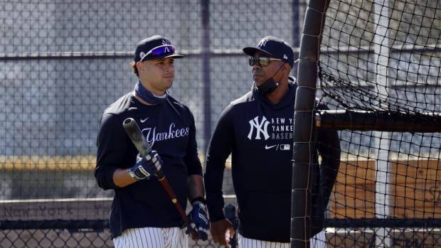 Yankees catcher Gary Sanchez with hitting coach Marcus Thames