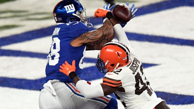New York Giants tight end Evan Engram (88) cannot come up with the touchdown pass with pressure from Cleveland Browns safety Karl Joseph (42) during a game at MetLife Stadium on Sunday, December 20, 2020, in East Rutherford.