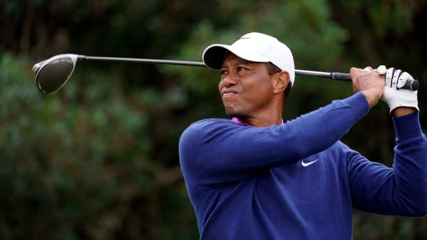 Tiger Woods plays his shot from the 18th tee during continuation of the second round of The Masters golf tournament at Augusta National GC.