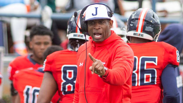 Jackson State University Coach Deion Sanders shouts instructions to his team during their game against Edward Waters at Mississippi Veterans Memorial Stadium Sunday, Feb. 21, 2021.