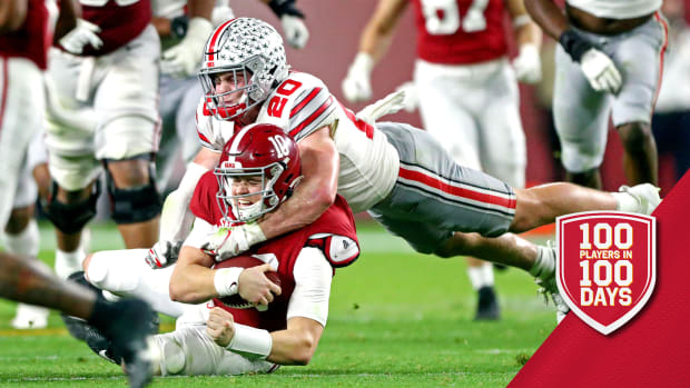 Jan 11, 2021; Miami Gardens, Florida, USA; Alabama Crimson Tide quarterback Mac Jones (10) is tackled by Ohio State Buckeyes linebacker Pete Werner (20) during the third quarter in the 2021 College Football Playoff National Championship Game. Mandatory Credit: Mark J. Rebilas-USA TODAY Sports