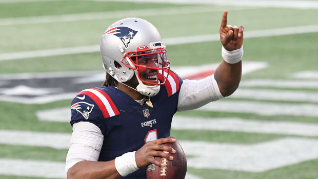 Patriots quarterback Cam Newton celebrates after scoring a touchdown against the Jets