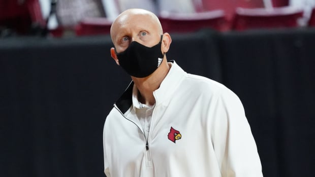 Louisville Cardinals head coach Chris Mack watches from the sideline as they take on the Boston College Eagles in the second half at Conte Forum.