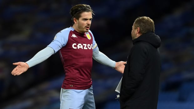 Aston Villa's Jack Grealish talking to his manager on the sideline