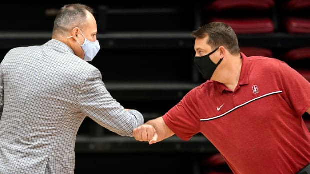 Cal coach Mark Fox, left, and Stanford's Jerod Haase