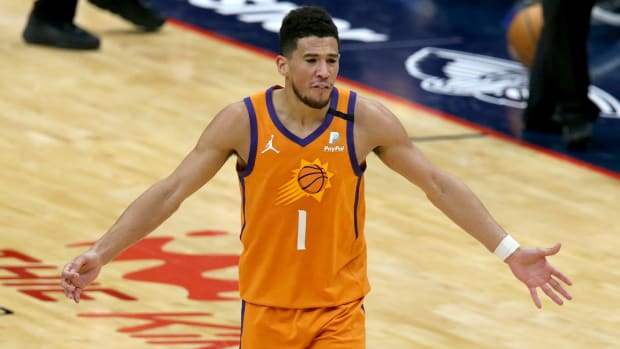 Suns' Devin Booker reacts during an NBA game