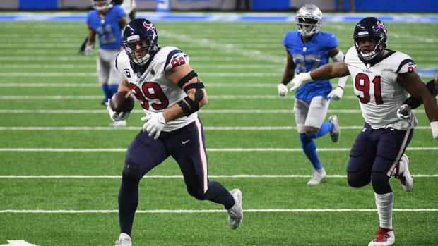 Texans defensive end J.J. Watt (99) runs for a touchdown after an interception against the Detroit Lions.