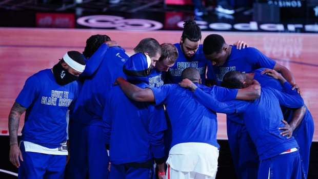 Feb 15, 2021; Los Angeles, California, USA; LA Clippers players huddle wearing Black History month shirts before the game against the Miami Heat at Staples Center. Mandatory Credit: Kirby Lee-USA TODAY Sports