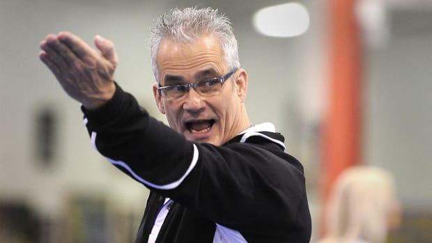 John Geddert, Jordyn Wieber's coach, gives instruction during a recent practice.