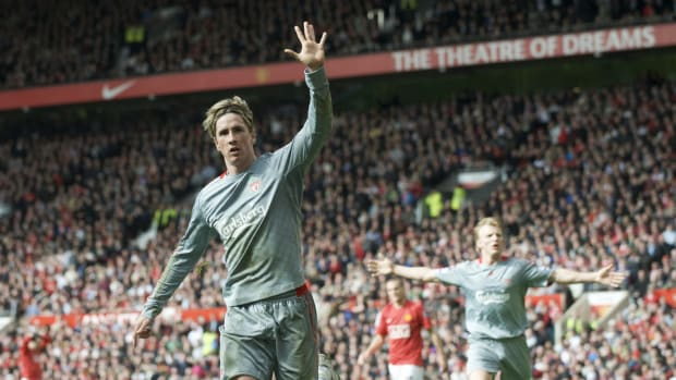 MANCHESTER, ENGLAND - Saturday, March 14, 2009: We've won it five times... Liverpool's Fernando Torres reminds fans of his club's European pedigree as he celebrates scoring the equalising goal against Manchester United during the Premiership match at Old Trafford. (Photo by David Rawcliffe/Propaganda)