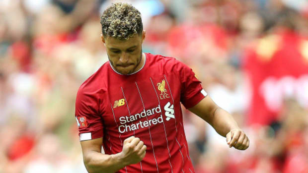 Alex Oxalde-Chamberlain celebrates after scoring for Liverpool.