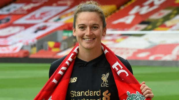 Rachael Laws holds a Liverpool scarf.