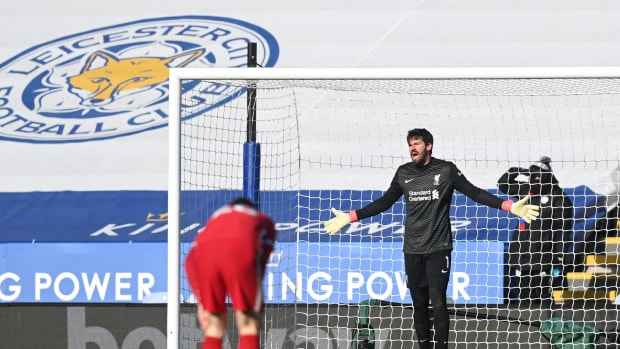 LEICESTER, ENGLAND - FEBRUARY 13: Alisson of Liverpool reacts after conceding a third goal during the Premier League match between Leicester City and Liverpool at The King Power Stadium on February 13, 2021 in Leicester, England. Sporting stadiums around the UK remain under strict restrictions due to the Coronavirus Pandemic as Government social distancing laws prohibit fans inside venues resulting in games being played behind closed doors. (Photo by Michael Regan/Getty Images)