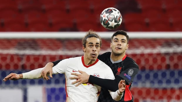 BUDAPEST, HUNGARY - FEBRUARY 16: Yussuf Poulsen of RB Leipzig and  Ozan Kabak of Liverpool battle for possession during the UEFA Champions League Round of 16 match between RB Leipzig and Liverpool FC at Puskas Arena on February 16, 2021 in Budapest, Hungary. Liverpool face RB Leipzig at a neutral venue in Budapest behind closed doors after Germany imposed a ban on travellers arriving from the UK in an effort to prevent the spread of Covid-19 variants. (Photo by Laszlo Szirtesi/Getty Images)