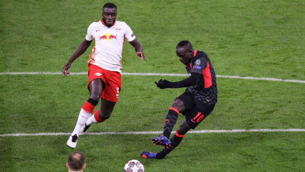 Liverpool's Senegalese striker Sadio Mane scores his team's second goal during the UEFA Champions League round of 16 first leg football match between RB Leipzig and FC Liverpool at the Puskas Arena in Budapest on February 16, 2021. (Photo by FERENC ISZA / AFP) (Photo by FERENC ISZA/AFP via Getty Images)