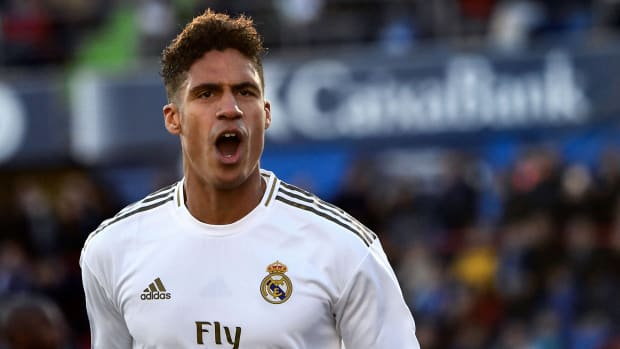 Real Madrid's French defender Raphael Varane celebrates his goal during the Spanish league football match between Getafe CF and Real Madrid CF at the Col. Alfonso Perez stadium in Getafe on January 4, 2020. (Photo by OSCAR DEL POZO / AFP) (Photo by OSCAR DEL POZO/AFP via Getty Images)
