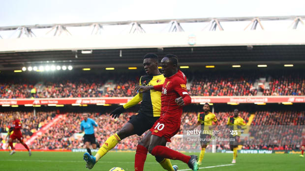 LIVERPOOL, ENGLAND - DECEMBER 14: Sadio Mane of Liverpool in action with Ismaila Sarr of Watford during the Premier League match between Liverpool FC and Watford FC at Anfield on December 14, 2019 in Liverpool, United Kingdom.