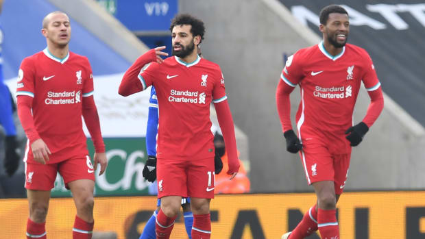 Liverpool's Egyptian midfielder Mohamed Salah  (C) celebrates with teammates after scoring his team's first goal during the English Premier League football match between Leicester City and Liverpool at King Power Stadium in Leicester, central England on February 13, 2021. (Photo by Paul ELLIS / POOL / AFP) / RESTRICTED TO EDITORIAL USE. No use with unauthorized audio, video, data, fixture lists, club/league logos or 'live' services. Online in-match use limited to 120 images. An additional 40 images may be used in extra time. No video emulation. Social media in-match use limited to 120 images. An additional 40 images may be used in extra time. No use in betting publications, games or single club/league/player publications. /  (Photo by PAUL ELLIS/POOL/AFP via Getty Images)