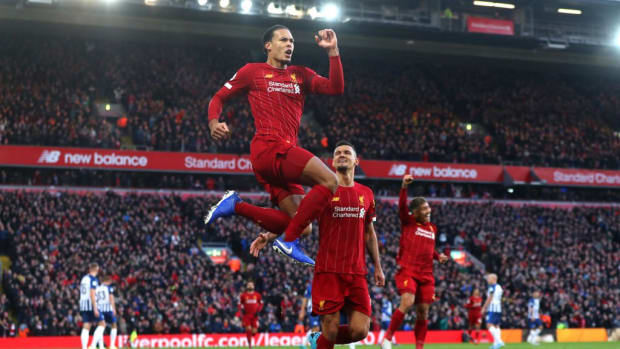 LIVERPOOL, ENGLAND - NOVEMBER 30:Virgil Van Dijk of Liverpool celebrates scoring his teams first goal  during the Premier League match between Liverpool FC and Brighton & Hove Albion at Anfield on November 30, 2019 in Liverpool, United Kingdom. (Photo by Chloe Knott - Danehouse/Getty Images)