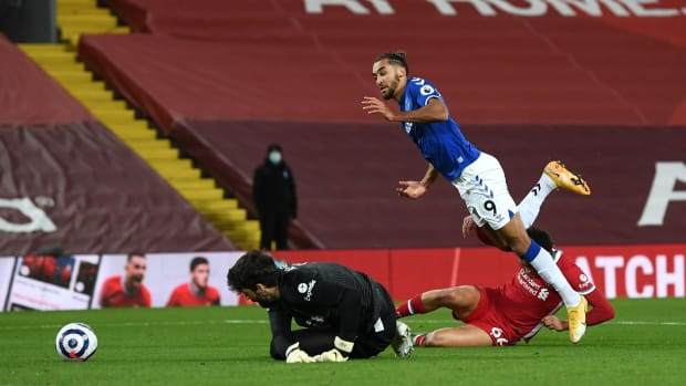 LIVERPOOL, ENGLAND - FEBRUARY 20: Dominic Calvert-Lewin of Everton is fouled by Trent Alexander-Arnold of Liverpool inside the penalty area, leading to Everton being awarded a penalty during the Premier League match between Liverpool and Everton at Anfield on February 20, 2021 in Liverpool, England. Sporting stadiums around the UK remain under strict restrictions due to the Coronavirus Pandemic as Government social distancing laws prohibit fans inside venues resulting in games being played behind closed doors. (Photo by Laurence Griffiths/Getty Images)