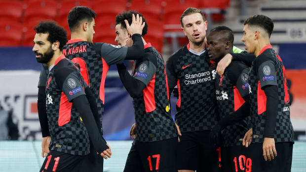 Liverpool players celebrate a goal against RB Leipzig in the Champions League