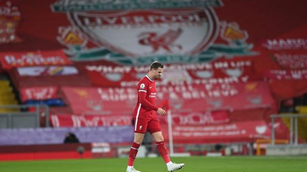 Jordan Henderson limps off after injury against Everton