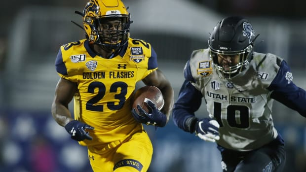 Dec 20, 2019; Frisco, TX, USA; Kent State Golden Flashes wide receiver Isaiah McKoy (23) runs the ball against Utah State Aggies defensive end Tipa Galeai (10) in the third quarter during the Frisco Bowl at Toyota Stadium. Mandatory Credit: Tim Heitman-USA TODAY Sports
