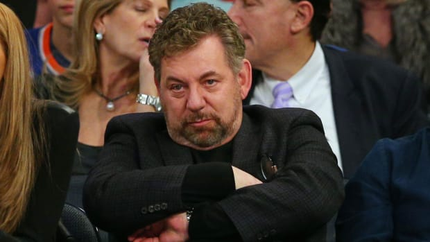 Knicks owner James Dolan on the sideline looking like a real grump