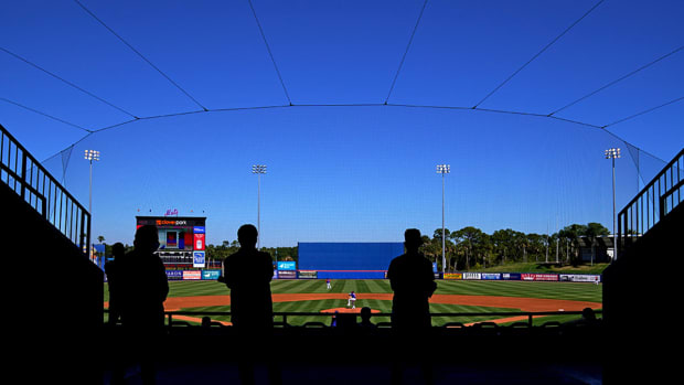 A spring training ballpark with a few fans