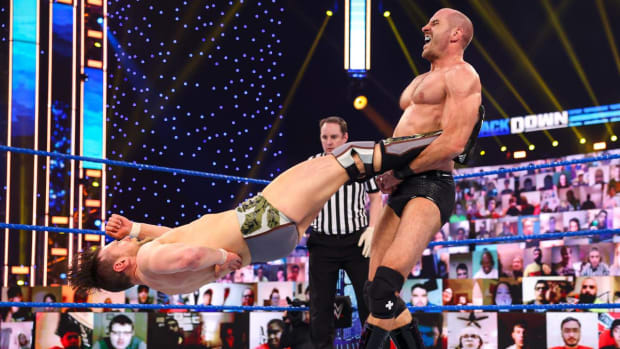 "WWE's Cesaro performs his signature ""Cesaro Swing"" on Daniel Bryan during a match on SmackDown"