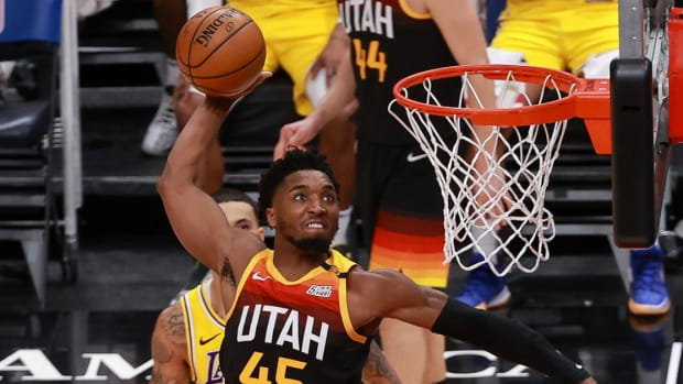 Utah Jazz guard Donovan Mitchell dunks the basketball