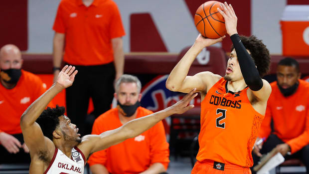 Cade Cunningham shoots over Oklahoma defender