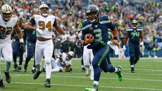 Russell Wilson running against the Saints