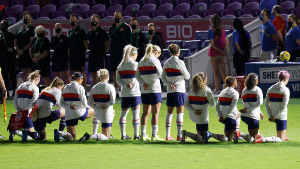 Members of the U.S. women's soccer team during the national anthem