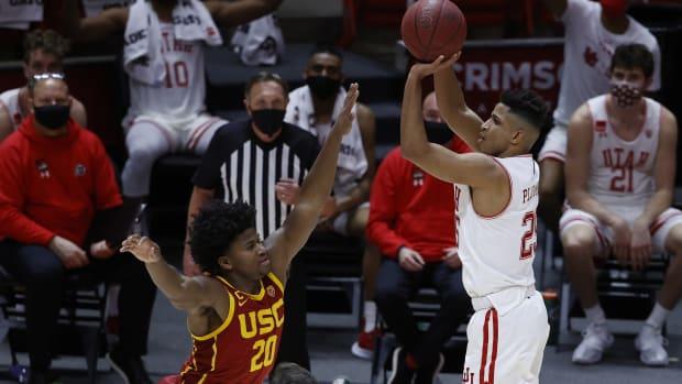 Feb 27, 2021; Salt Lake City, Utah, USA; Utah Utes guard Alfonso Plummer (25) shoot for a three against USC Trojans guard Ethan Anderson (20) in the second half at Jon M. Huntsman Center.
