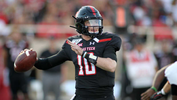 Texas Tech quarterback Alan Bowman attempts a pass during a game.
