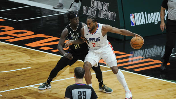 Feb 28, 2021; Milwaukee, Wisconsin, USA; Milwaukee Bucks guard Jrue Holiday (21) defends LA Clippers forward Kawhi Leonard (2) in the fourth quarter at Fiserv Forum. Mandatory Credit: Michael McLoone-USA TODAY Sports