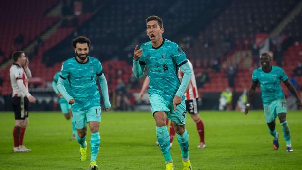 Roberto Firmino (C), Mohamed Salah (L) and Sadio Mane (R) celebrate