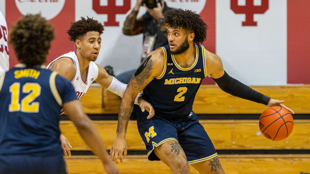 Michigan forward Isaiah Livers dribbles the ball while Indiana guard Rob Phinisee defends