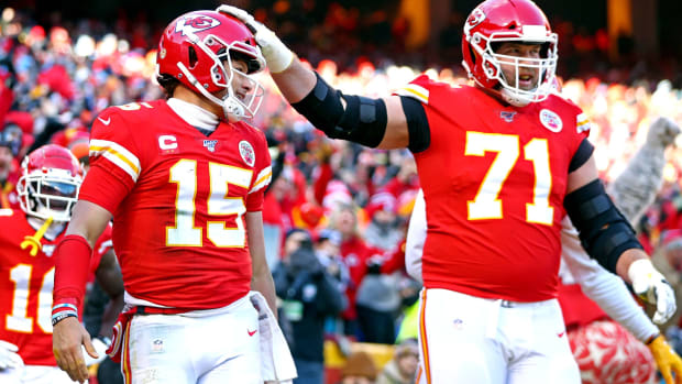 Jan 19, 2020; Kansas City, Missouri, USA; Kansas City Chiefs quarterback Patrick Mahomes (15) celebrates with offensive tackle Mitchell Schwartz (71) in the AFC Championship Game at Arrowhead Stadium. Mandatory Credit: Mark J. Rebilas-USA TODAY Sports